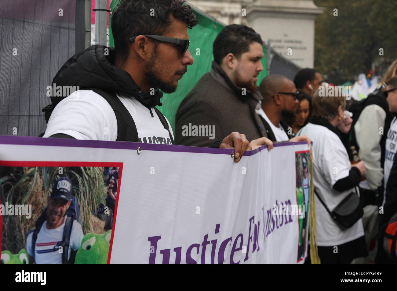 London, UK, 27th October, 2018. Friends, family and supporters campaigning for justice for people who died in custody, or while being arrested  take part In the 20th annual march organised by the United Families and Friends Campaign. Protesters hold a banner calling for justice for Winston Augustine, who died in Wormwood Scrubs prison earlier this year. The march  goes from Trafalger Square to Downing Street, where a petition is handed in. Roland Ravenhill/Alamy Live News. - Stock Image