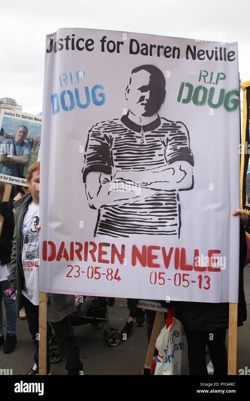 London, UK, 27th October, 2018. Friends, family and supporters campaigning for justice for people who died in custody, or while being arrested  take part In the 20th annual march organised by the United Families and Friends Campaign. The march  goes from Trafalger Square to Downing Street, where a petition is handed in. Darren Neville died in 2013 after being retrained by police. Roland Ravenhill/Alamy Live News. - Stock Image