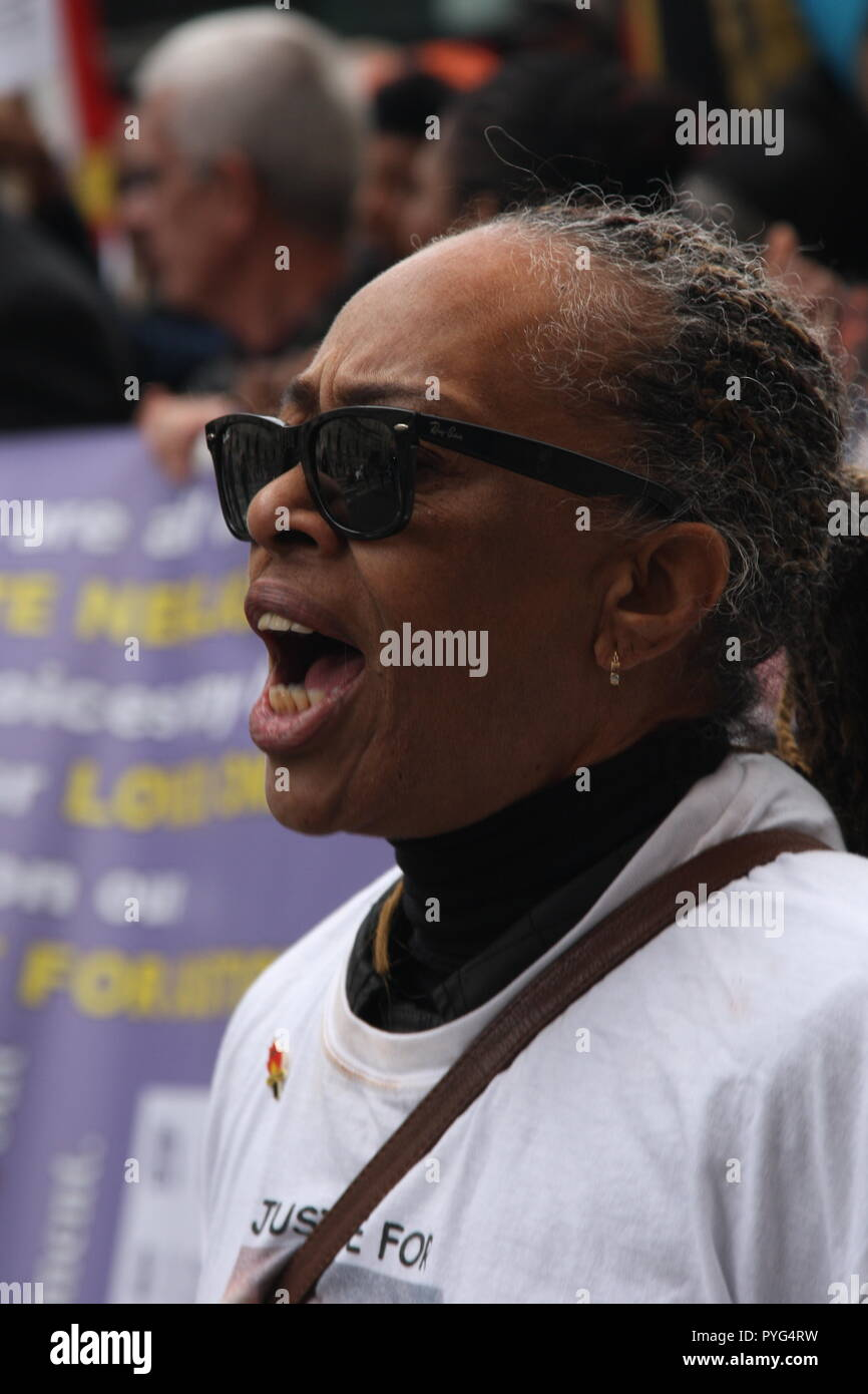 London, UK, 27th October, 2018. Stephanie Lightfoot-Bennet, twin sister of  Leon Patterson who died in police custody in 1992;  Friends, family and supporters campaigning for justice for people who died in custody, or while being arrested  take part In the 20th annual march organised by the United Families and Friends Campaign. The march  goes from Trafalger Square to Downing Street, where a petition is handed in. Roland Ravenhill/Alamy Live News. - Stock Image