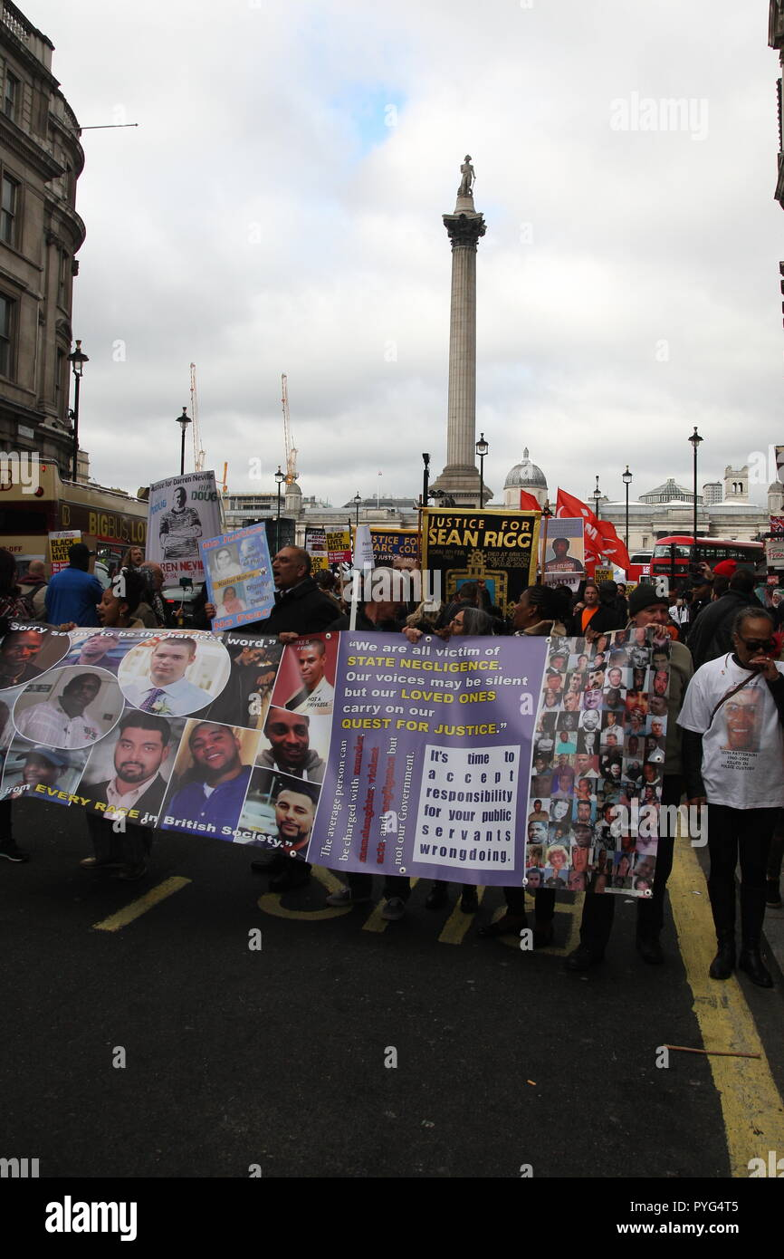 London, UK, 27th October, 2018. Friends, family and supporters campaigning for justice for people who died in custody, or while being arrested  take part In the 20th annual march organised by the United Families and Friends Campaign. The march  goes from Trafalgar Square to Downing Street, where a petition is handed in. Roland Ravenhill/Alamy Live News. - Stock Image
