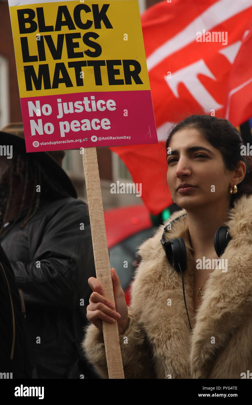 London, UK, 27th October, 2018. Friends, family and supporters campaigning for justice for people who died in custody, or while being arrested  take part In the 20th annual march organised by the United Families and Friends Campaign. The march  goes from Trafalger Square to Downing Street, where a petition is handed in. Roland Ravenhill/Alamy Live News. - Stock Image