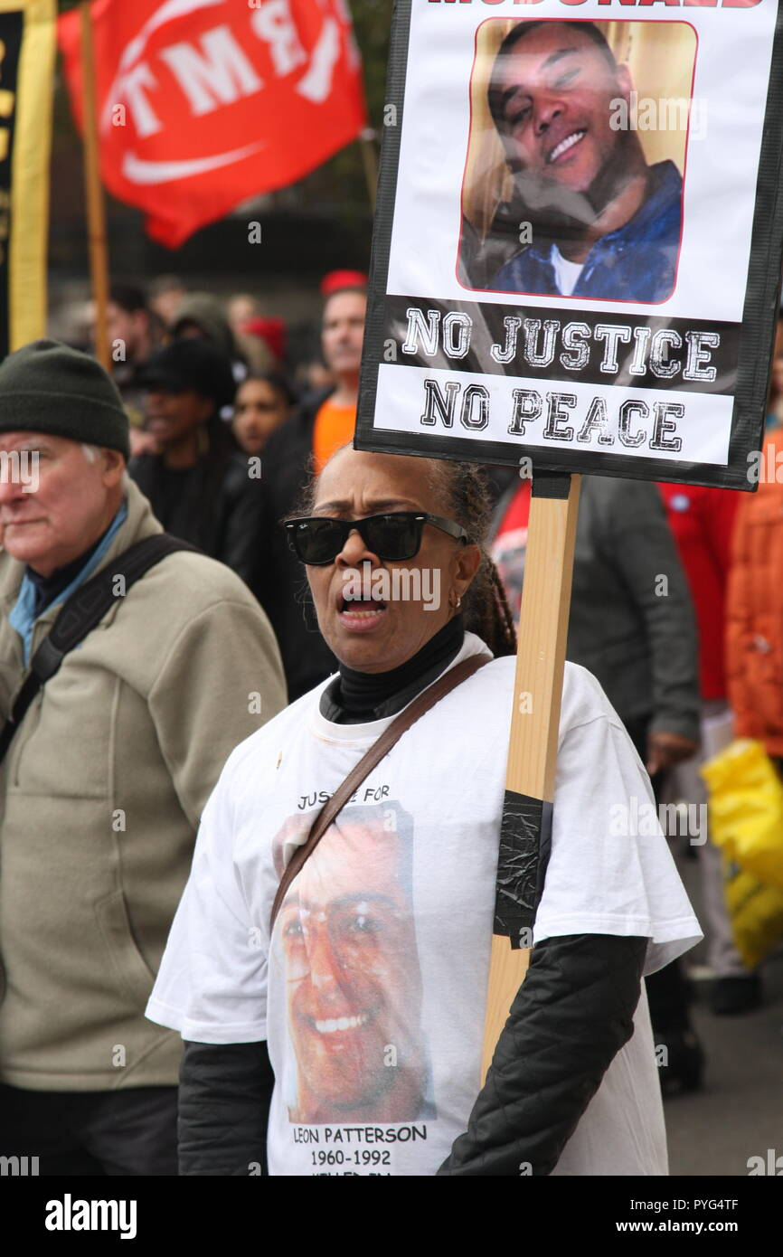 London, UK, 27th October, 2018. Friends, family and supporters campaigning for justice for people who died in custody, or while being arrested  take part In the 20th annual march organised by the United Families and Friends Campaign. One participant is Stephanie Lightfoot-Bennet, twin sister of  Leon Patterson who died in police custody in 1992. The march  goes from Trafalgar Square to Downing Street, where a petition is handed in. Roland Ravenhill/Alamy Live News. - Stock Image