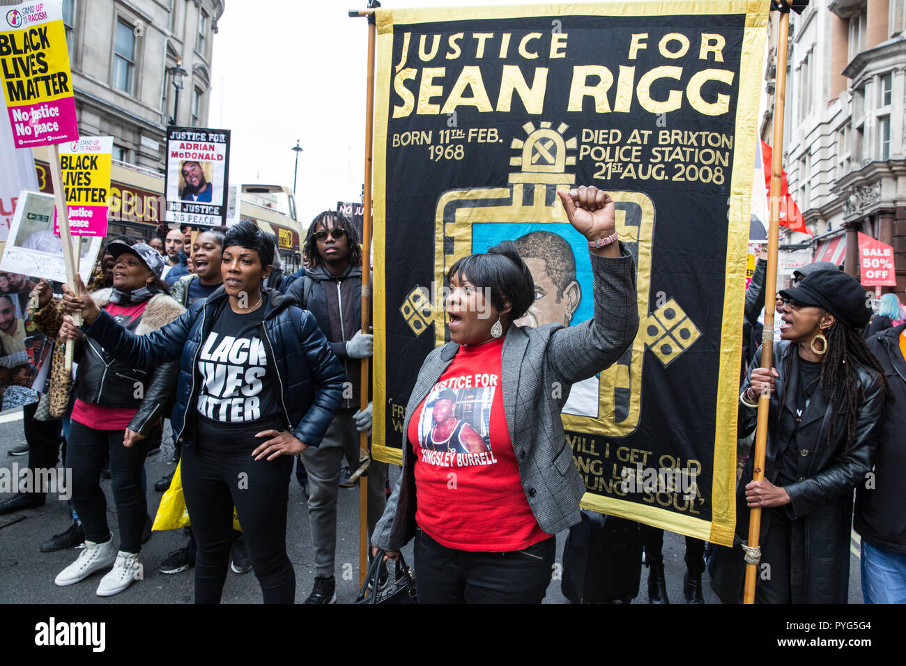 London, UK. 27th October, 2018. Kadisha Brown-Burrell, sister of Kingsley Burrell, and Marcia Rigg, sister of Sean Rigg, march with fellow campaigners from the United Families and Friends Campaign (UFFC) taking part in the 20th annual procession to Downing Street in remembrance of family members and friends who died in police custody, prison, immigration detention or secure psychiatric hospitals. Credit: Mark Kerrison/Alamy Live News - Stock Image