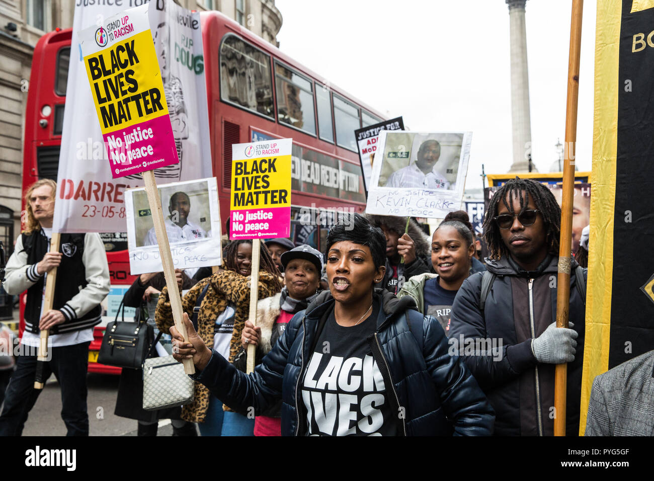 London, UK. 27th October, 2018. Kadisha Brown-Burrell, sister of Kingsley Burrell, marches with fellow campaigners from the United Families and Friends Campaign (UFFC) taking part in the 20th annual procession to Downing Street in remembrance of family members and friends who died in police custody, prison, immigration detention or secure psychiatric hospitals. Kingsley Burrell, 29, died from a cardiac arrest in March 2011 after being restrained whilst detained by West Midlands Police. Credit: Mark Kerrison/Alamy Live News - Stock Image