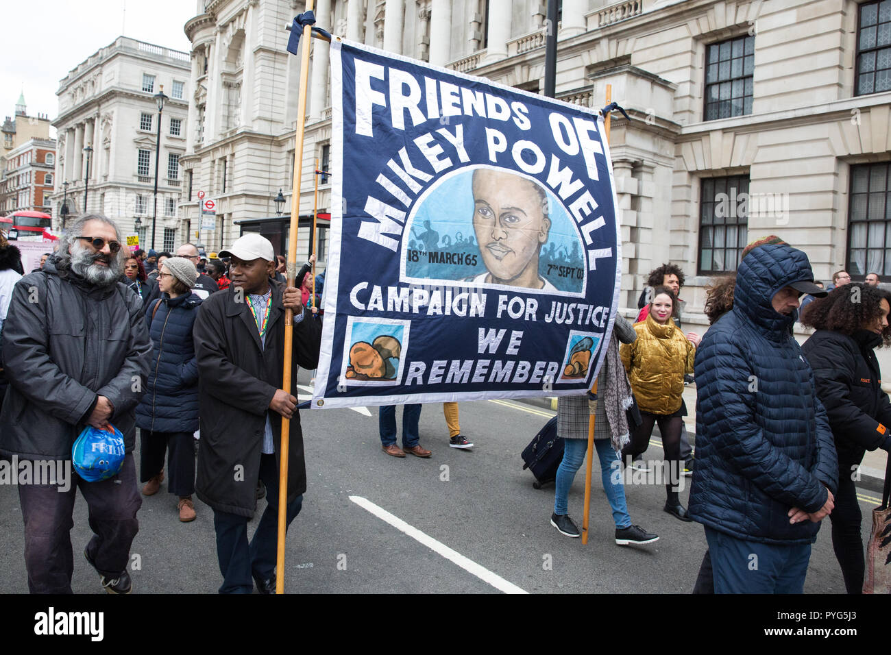 London, UK. 27th October, 2018. Tipper Naphtali, cousin of Mikey Powell, marches with campaigners from the United Families and Friends Campaign (UFFC) taking part in the 20th annual procession to Downing Street in remembrance of family members and friends who died in police custody, prison, immigration detention or secure psychiatric hospitals. Credit: Mark Kerrison/Alamy Live News - Stock Image