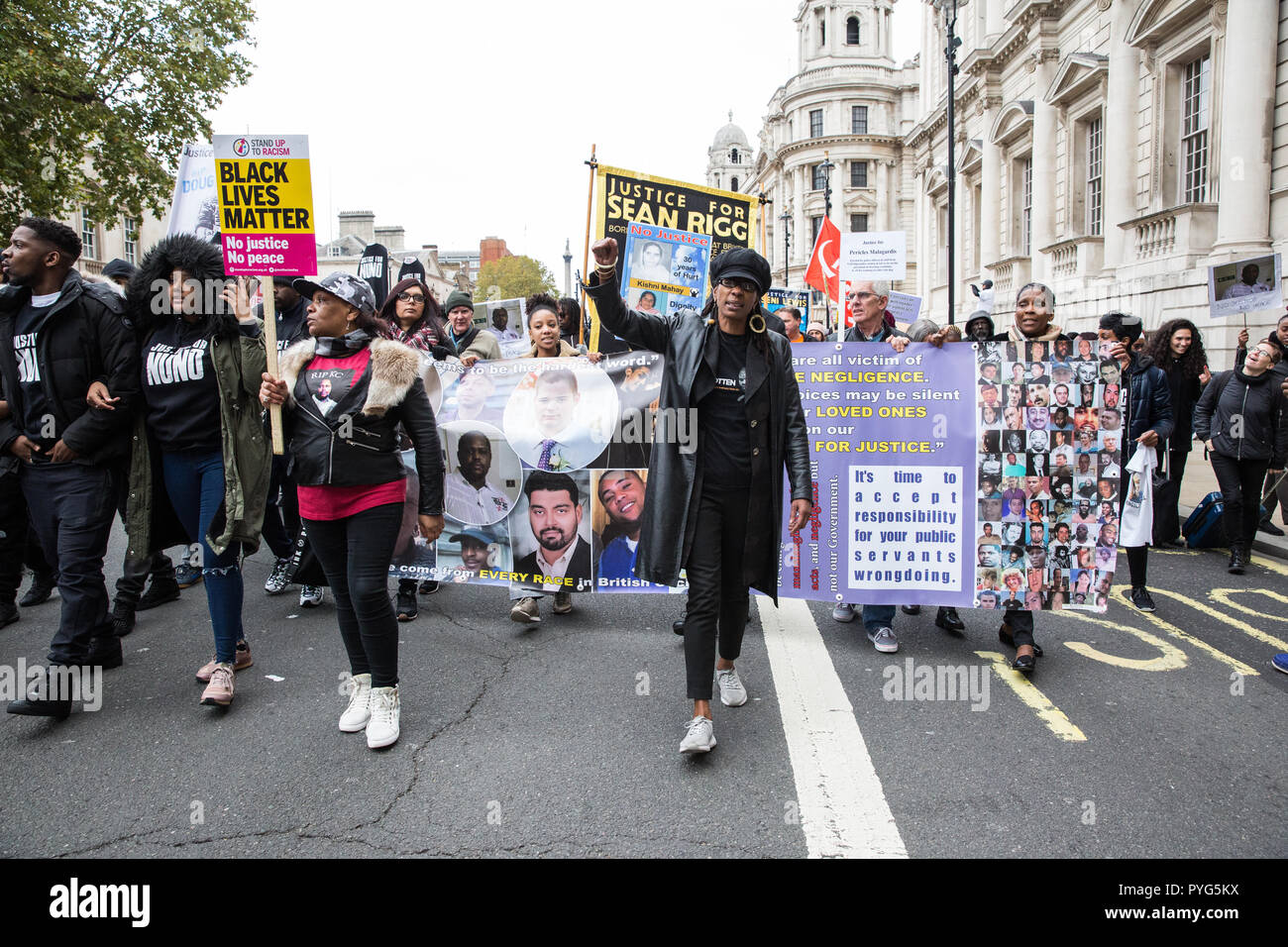 London, UK. 27th October, 2018. Marcia Rigg, sister of Sean Rigg, marches with campaigners from the United Families and Friends Campaign (UFFC) taking part in the 20th annual procession to Downing Street in remembrance of family members and friends who died in police custody, prison, immigration detention or secure psychiatric hospitals. Credit: Mark Kerrison/Alamy Live News - Stock Image