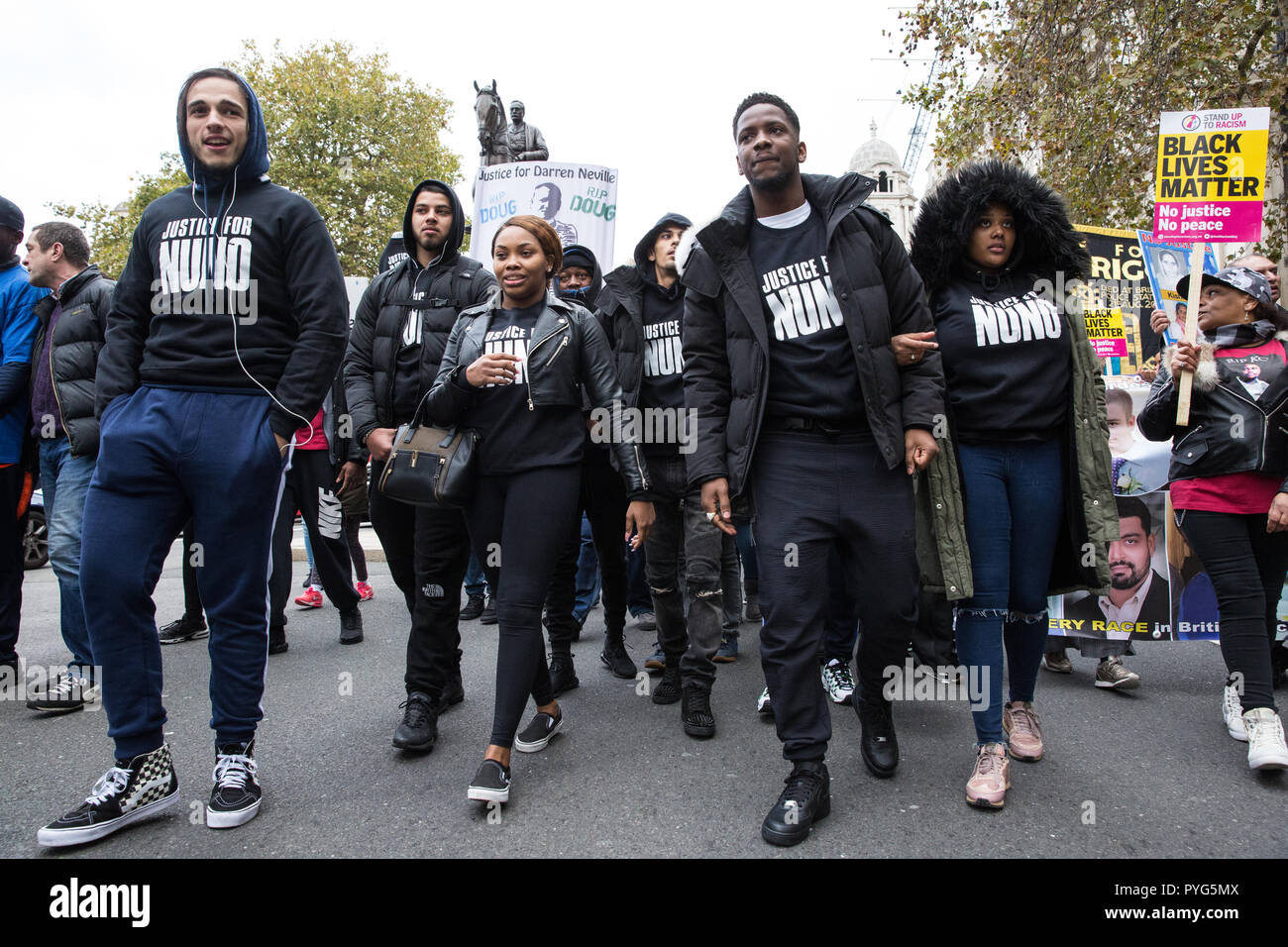 London, UK. 27th October, 2018. Supporters of the Justice for Nuno Cardoso campaign join campaigners from the United Families and Friends Campaign (UFFC) taking part in the 20th annual procession to Downing Street in remembrance of family members and friends who died in police custody, prison, immigration detention or secure psychiatric hospitals. Credit: Mark Kerrison/Alamy Live News - Stock Image