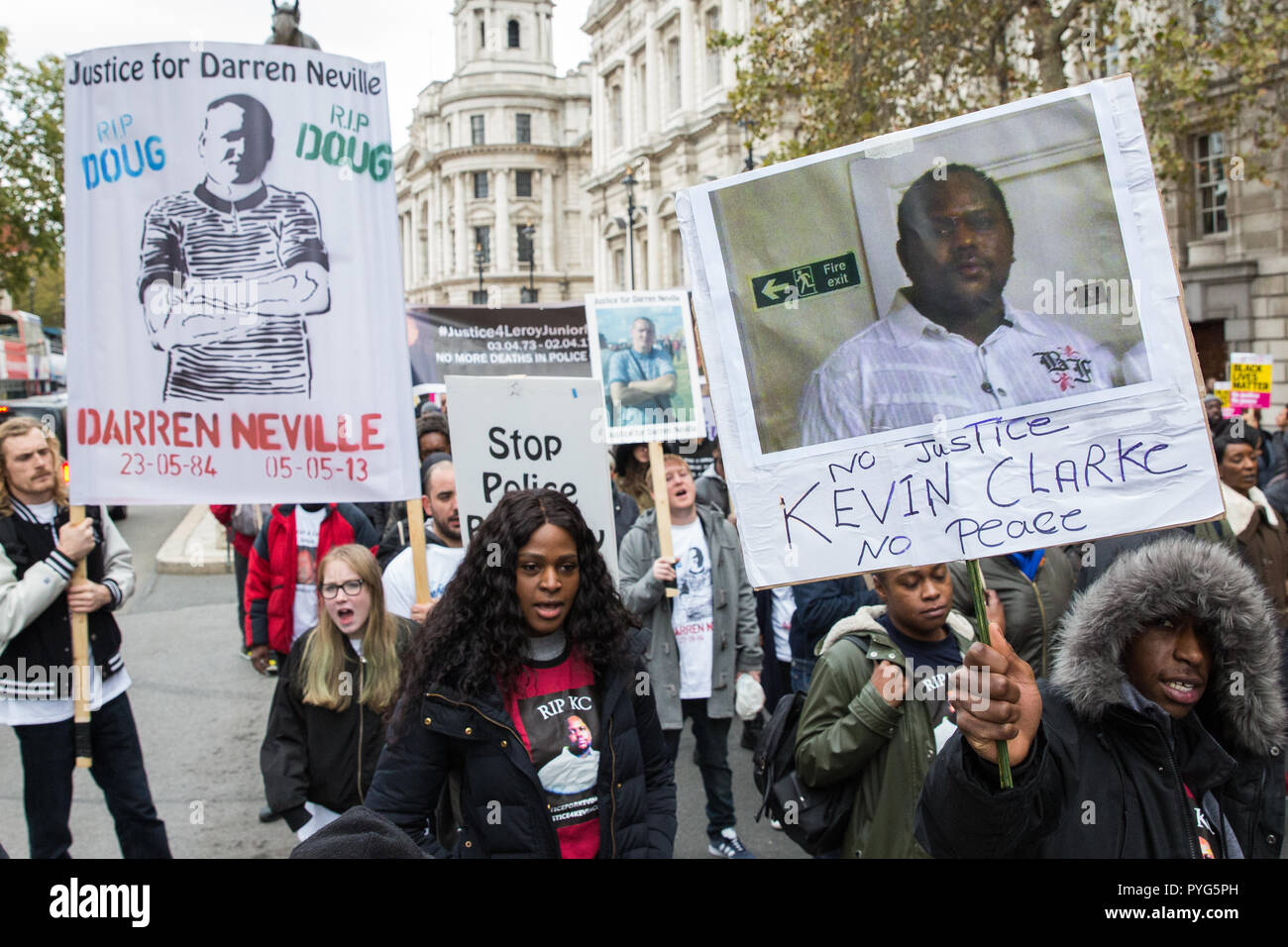 London, UK. 27th October, 2018. Campaigners from the United Families and Friends Campaign (UFFC) take part in the 20th annual procession to Downing Street in remembrance of family members and friends who died in police custody, prison, immigration detention or secure psychiatric hospitals. Credit: Mark Kerrison/Alamy Live News - Stock Image