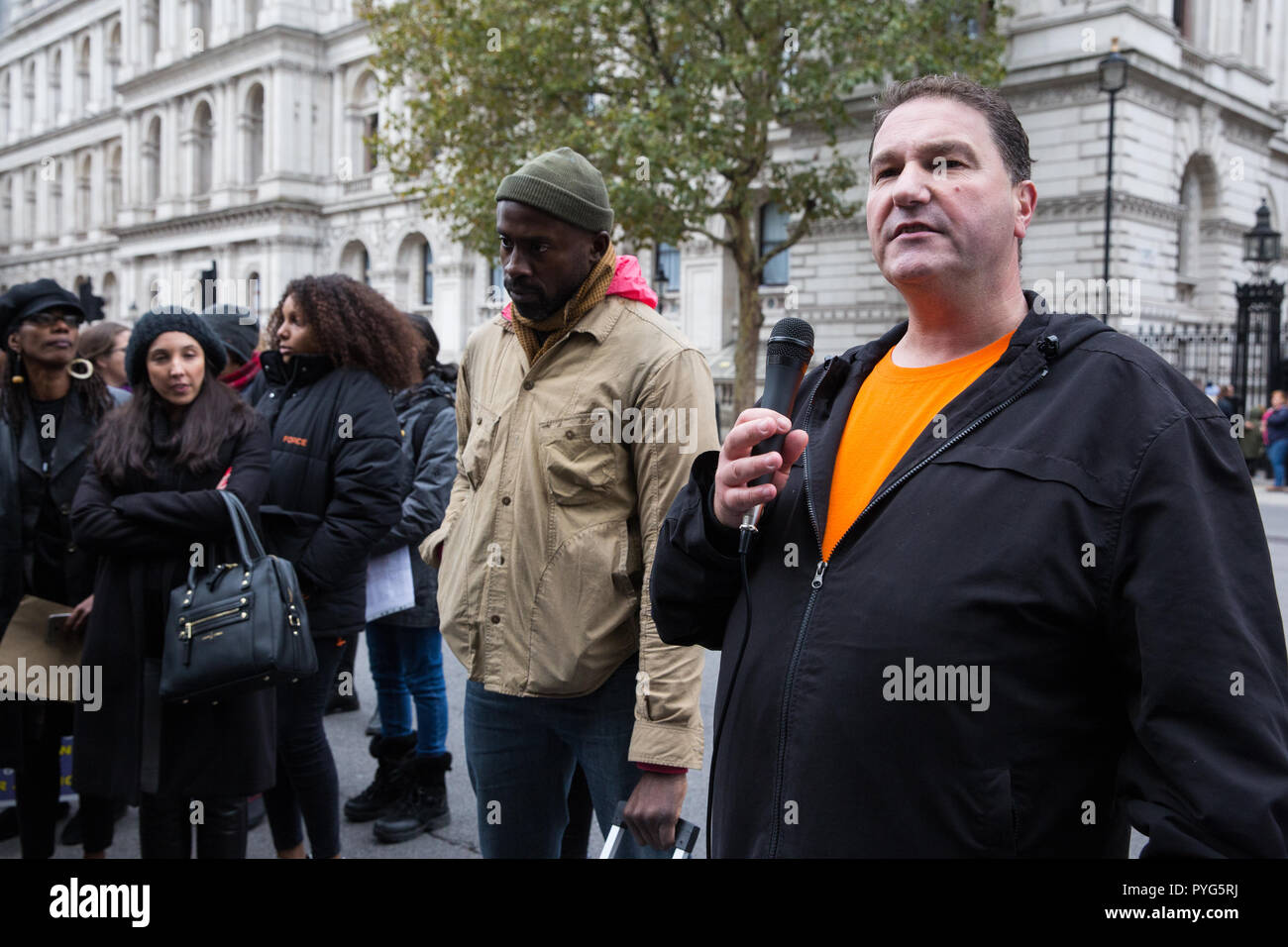 London, UK. 27th October, 2018. A relative of Mark Saunders addresses campaigners from the United Families and Friends Campaign (UFFC) taking part in the 20th annual procession to Downing Street in remembrance of family members and friends who died in police custody, prison, immigration detention or secure psychiatric hospitals. Credit: Mark Kerrison/Alamy Live News - Stock Image