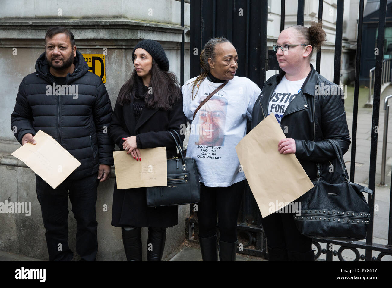 London, UK. 27th October, 2018. Campaigners from the United Families and Friends Campaign (UFFC) prepare to present letters at Downing Street following the 20th annual procession in remembrance of family members and friends who died in police custody, prison, immigration detention or secure psychiatric hospitals. UFFC was set up in 1997 by families who had lost loved ones at the hands of the state with the intention of challenging systemic injustice. Credit: Mark Kerrison/Alamy Live News - Stock Image