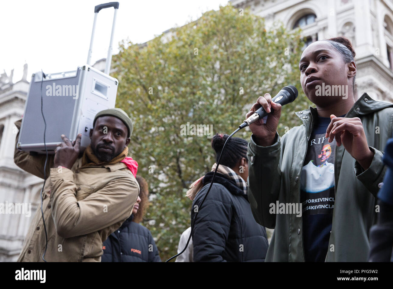 London, UK. 27th October, 2018. Tellecia Clarke, sister of Kevin Clarke, addresses campaigners from the United Families and Friends Campaign (UFFC) taking part in the 20th annual procession to Downing Street in remembrance of family members and friends who died in police custody, prison, immigration detention or secure psychiatric hospitals. Kevin Clarke, 35, died in Lewisham in March 2018 after being restrained by up to 9 police officers while having a mental health crisis. Credit: Mark Kerrison/Alamy Live News - Stock Image