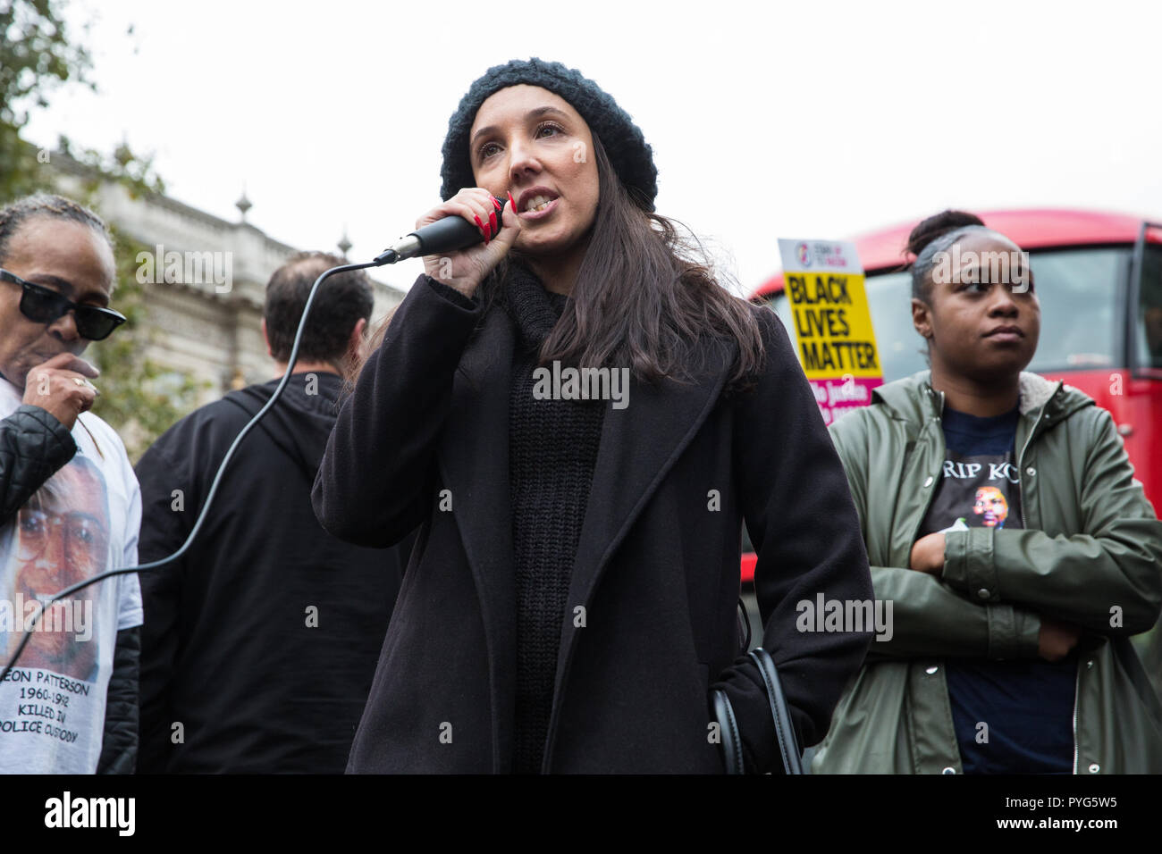 London, UK. 27th October, 2018. Lisa Cole, sister of Marc Cole, addresses campaigners from the United Families and Friends Campaign (UFFC) taking part in the 20th annual procession to Downing Street in remembrance of family members and friends who died in police custody, prison, immigration detention or secure psychiatric hospitals. Marc Cole, 30, died after being tasered by police called to reports of a man 'slashing himself' with a knife in Falmouth in May 2017. Credit: Mark Kerrison/Alamy Live News - Stock Image