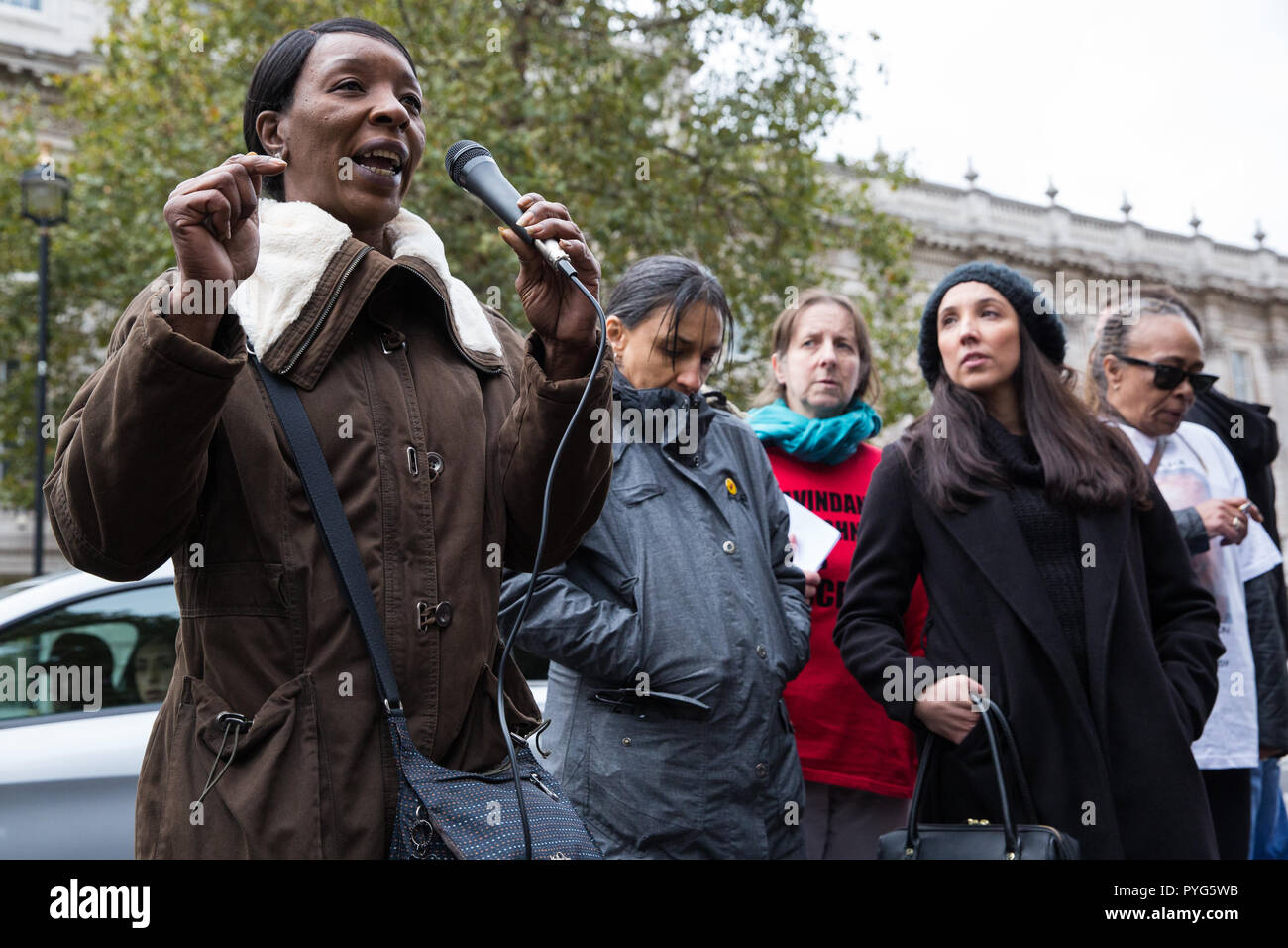 London, UK. 27th October, 2018. Marilyn Reed, mother of Sarah Reed, addresses campaigners from the United Families and Friends Campaign (UFFC) taking part in the 20th annual procession to Downing Street in remembrance of family members and friends who died in police custody, prison, immigration detention or secure psychiatric hospitals. Sarah Reed, 32, was found dead in a cell at Holloway prison on 11th January 2016. Credit: Mark Kerrison/Alamy Live News - Stock Image