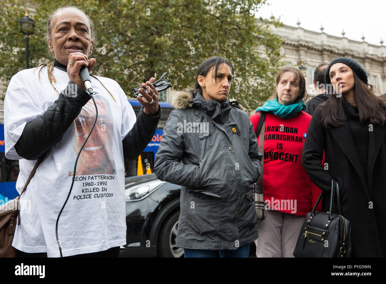 London, UK. 27th October, 2018. Stephanie Lightfoot-Bennett, twin sister of Leon Patterson, addresses campaigners from the United Families and Friends Campaign (UFFC) taking part in the 20th annual procession to Downing Street in remembrance of family members and friends who died in police custody, prison, immigration detention or secure psychiatric hospitals. Leon Patterson died in November 1992 after spending a week in custody at Stockport police station. Credit: Mark Kerrison/Alamy Live News - Stock Image