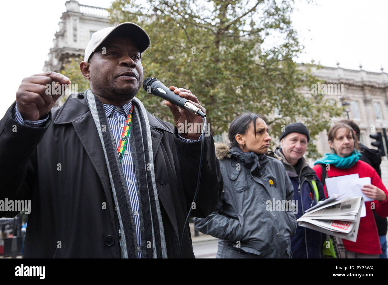 London, UK. 27th October, 2018. Tipper Naphtali, housing of Mikey Powell, addresses campaigners from the United Families and Friends Campaign (UFFC) taking part in the 20th annual procession to Downing Street in remembrance of family members and friends who died in police custody, prison, immigration detention or secure psychiatric hospitals. Mikey Powell, 38, died of asphyxiation shortly after being arrested by West Midlands police in 2003. Credit: Mark Kerrison/Alamy Live News - Stock Image