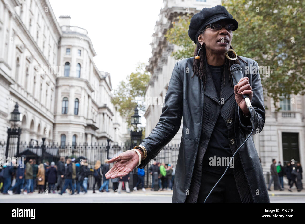 London, UK. 27th October, 2018. Marcia Rigg, sister of Sean Rigg, addresses campaigners from the United Families and Friends Campaign (UFFC) taking part in the 20th annual procession to Downing Street in remembrance of family members and friends who died in police custody, prison, immigration detention or secure psychiatric hospitals. Sean Rigg, 40, died on 21st August 2008 while in police custody at Brixton police station. Credit: Mark Kerrison/Alamy Live News - Stock Image