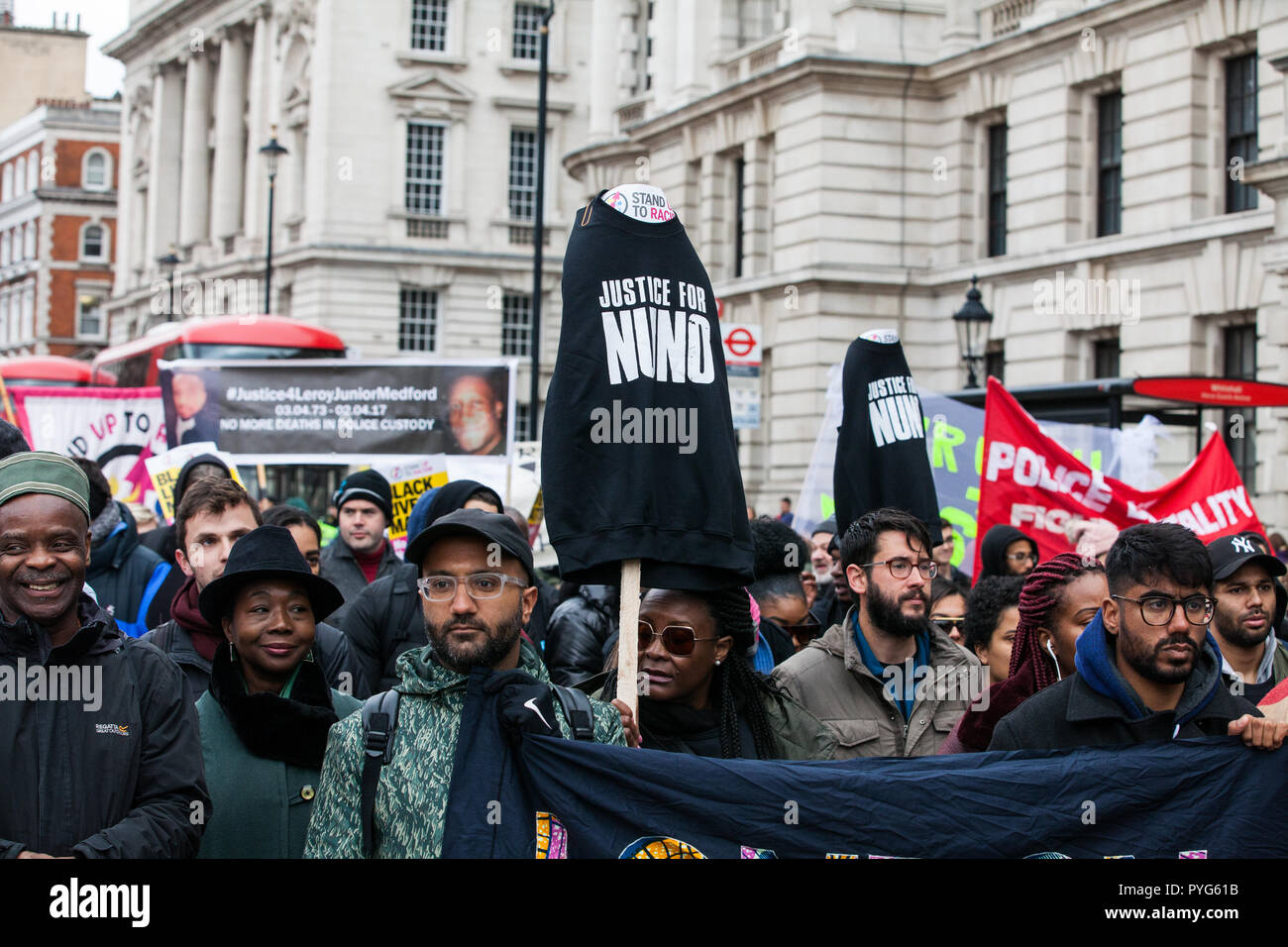 London, UK. 27th October, 2018. Supporters of the Justice for Nuno Cardoso campaign join campaigners from United Families and Friends Campaign (UFFC) taking part in the 20th annual procession to Downing Street in remembrance of family members and friends who died in police custody, prison, immigration detention or secure psychiatric hospitals. Credit: Mark Kerrison/Alamy Live News - Stock Image