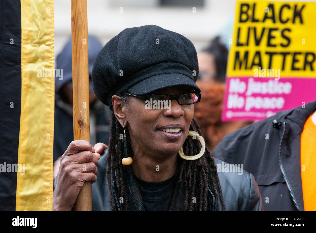 London, UK. 27th October, 2018. Marcia Rigg, sister of Sean Rigg, marches with fellow campaigners from the United Families and Friends Campaign (UFFC) taking part in the 20th annual procession to Downing Street in remembrance of family members and friends who died in police custody, prison, immigration detention or secure psychiatric hospitals. Credit: Mark Kerrison/Alamy Live News - Stock Image