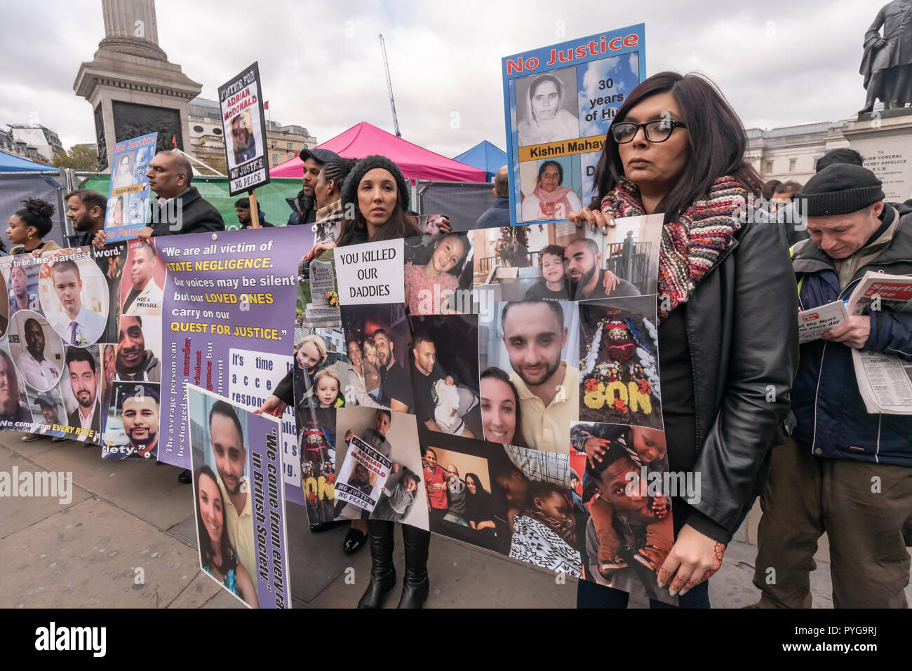 London, UK. 27th October 2018.  The United Families and Friends Campaign (UFFC), a coalition of of people killed by police, in prisons, in immigration detention and in secure psychiatric hospitals meet in Trafalgar Square for the 20th annual march of remembrance at a funereal pace to Downing St. Credit: Peter Marshall/Alamy Live News - Stock Image