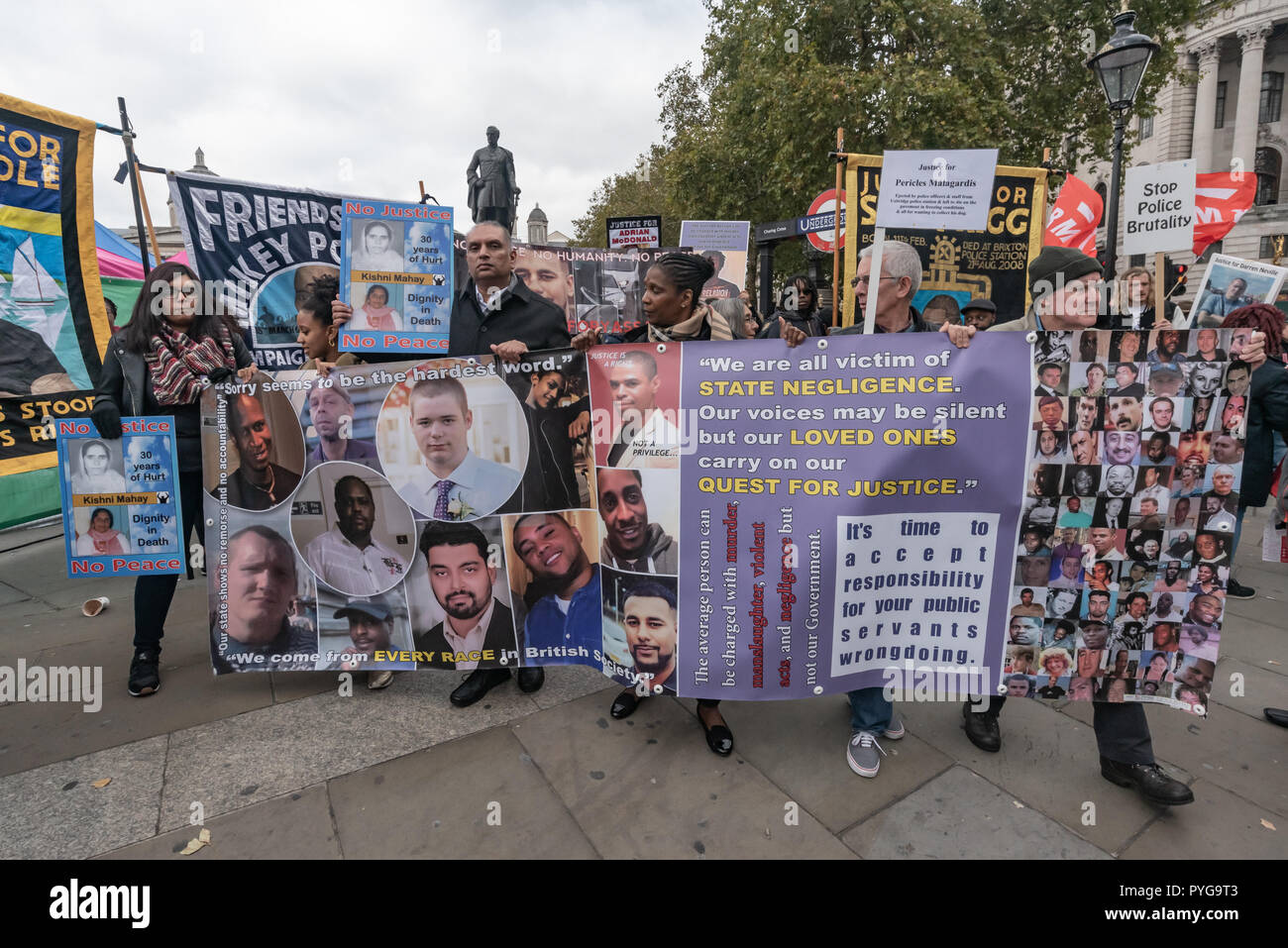London, UK. 27th October 2018.  The United Families and Friends Campaign (UFFC), a coalition of of people killed by police, in prisons, in immigration detention and in secure psychiatric hospitals begin their 20th annual march of remembrance from Trafalgar Square at a funereal pace to Downing St. Credit: Peter Marshall/Alamy Live News - Stock Image