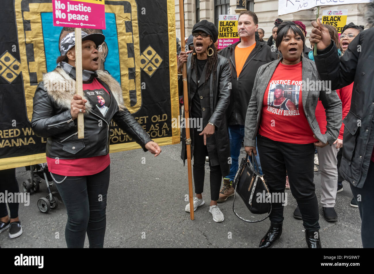 London, UK. 27th October 2018.  The United Families and Friends Campaign (UFFC), a coalition of of people killed by police, in prisons, in immigration detention and in secure psychiatric hospitals march from Trafalgar Square and make their 20th annual march of remembrance at a funereal pace to Downing St. Credit: Peter Marshall/Alamy Live News - Stock Image