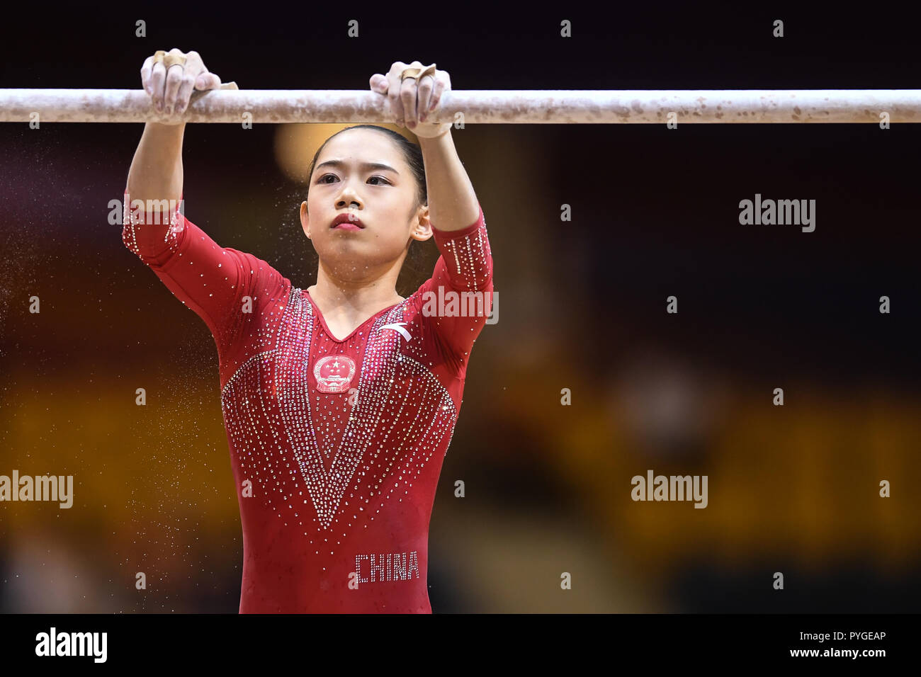 Doha, Qatar. 28th Oct, 2018. LIU TINGTING chalks up the uneven bars during the second day of preliminary competition held at the Aspire Dome in Doha, Qatar. Credit: Amy Sanderson/ZUMA Wire/Alamy Live News Stock Photo