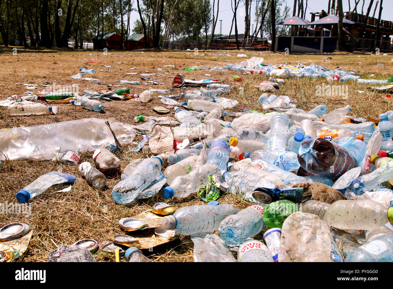 Belgrade, Serbia - June 25, 2017: Plastic pet bottles left on grass after an party, event. Used empty bottles thrown away on the ground after an open. Stock Photo