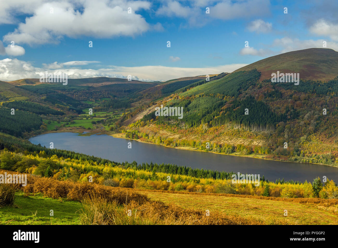 The Talybont Reservoir and Valley in the Central Brecon Beacons seen from Bwlch y Waun above. The shot was taken on a bright and cold autumn morning - Stock Image
