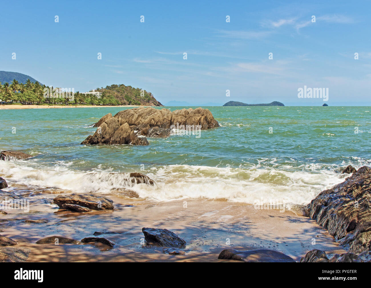 The scenic Trinity Beach from the south end looking northward towards Palm Cove in the Coral Sea. - Stock Image