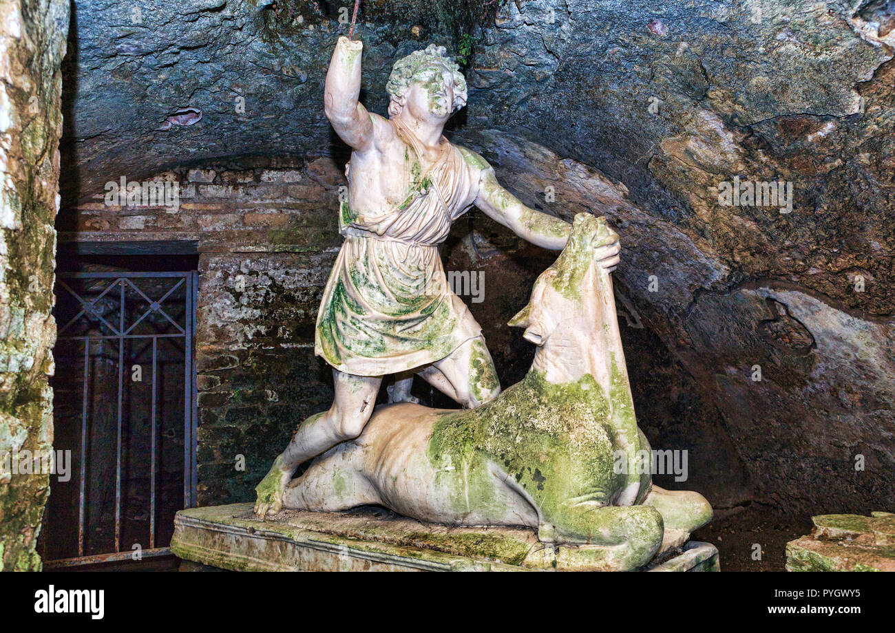 Statue of the god Mithras killing a bull in the thermal s mithraeum in archaeological excavations of Ostia Antica - Rome - Stock Image