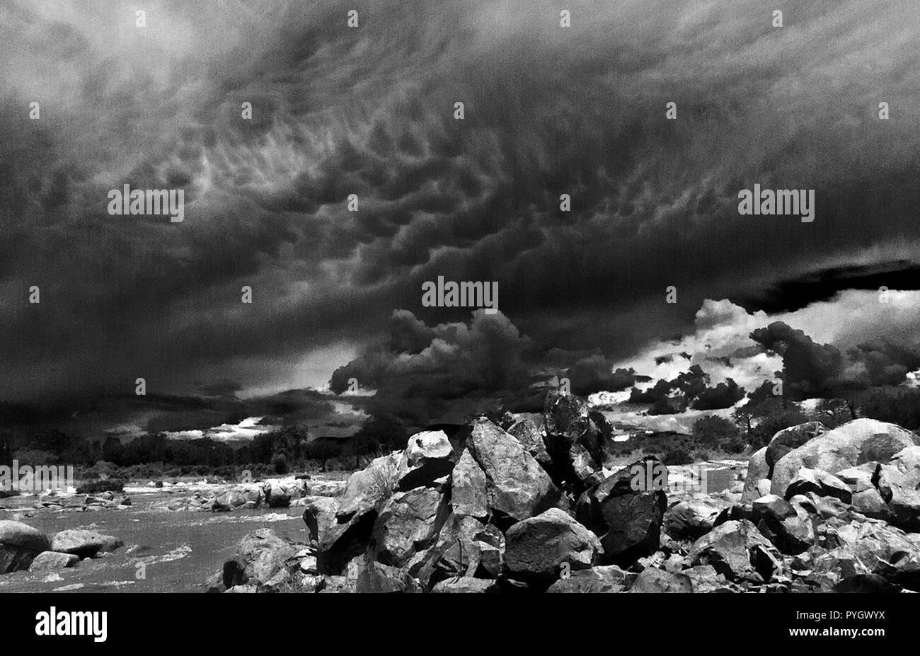 A huge storm developes on the Southern Highlands Escarpment that sweeps down the Valley of the Great Ruaha River - Stock Image