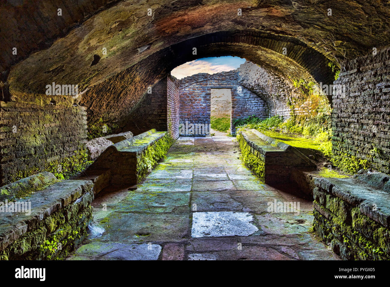 Looking at the exit inside the thermal's mithraeum in archaeological excavations of Ostia Antica - Rome - Stock Image