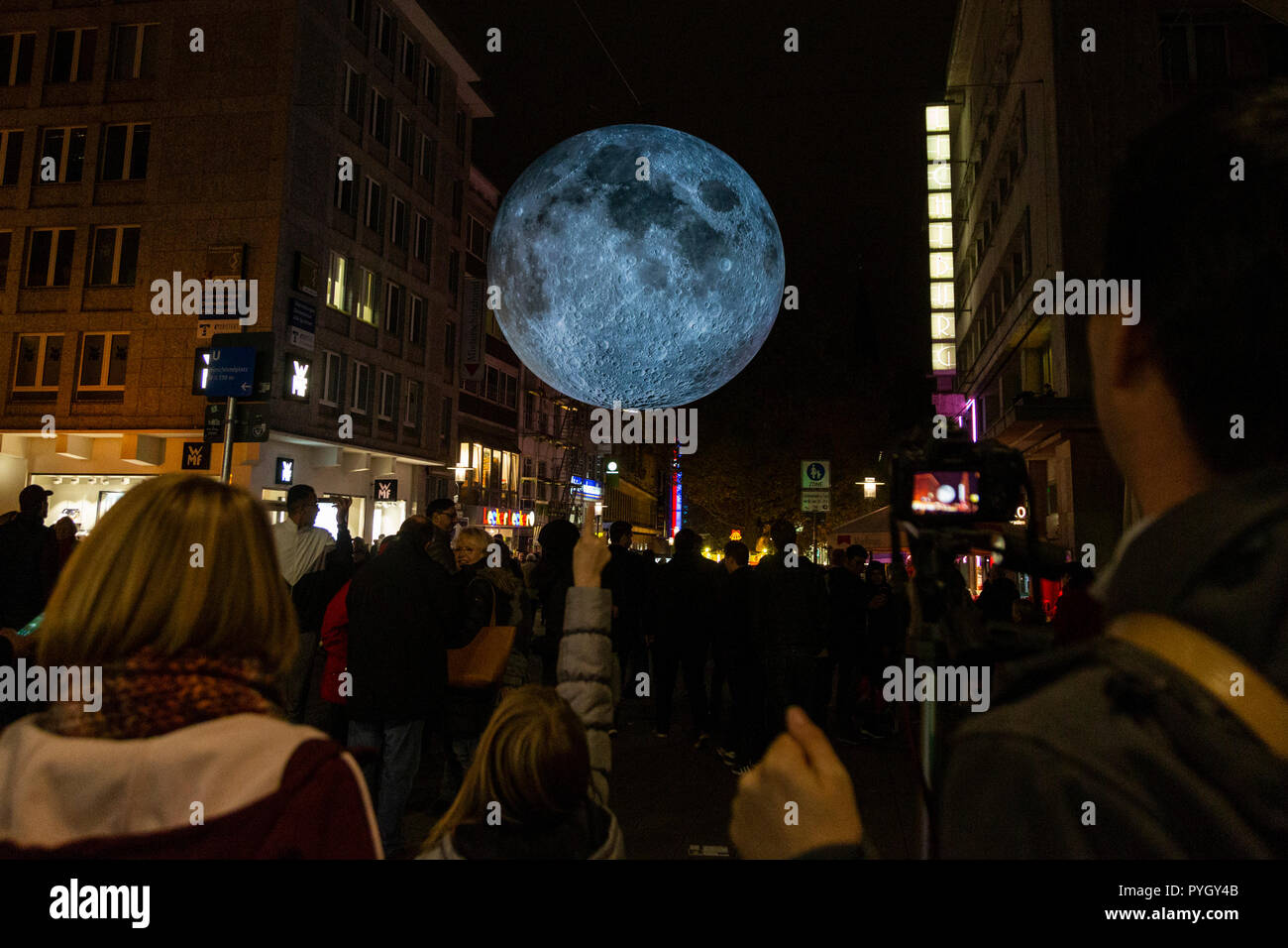 Essen, Germany. Giant Moon above Kettwiger Straße street. Museum of the Moon by British artist Luke Jerram. The 2018 Essen Light Festival gets under way with many light art installations throughout the town centre until 4 November 2018. - Stock Image