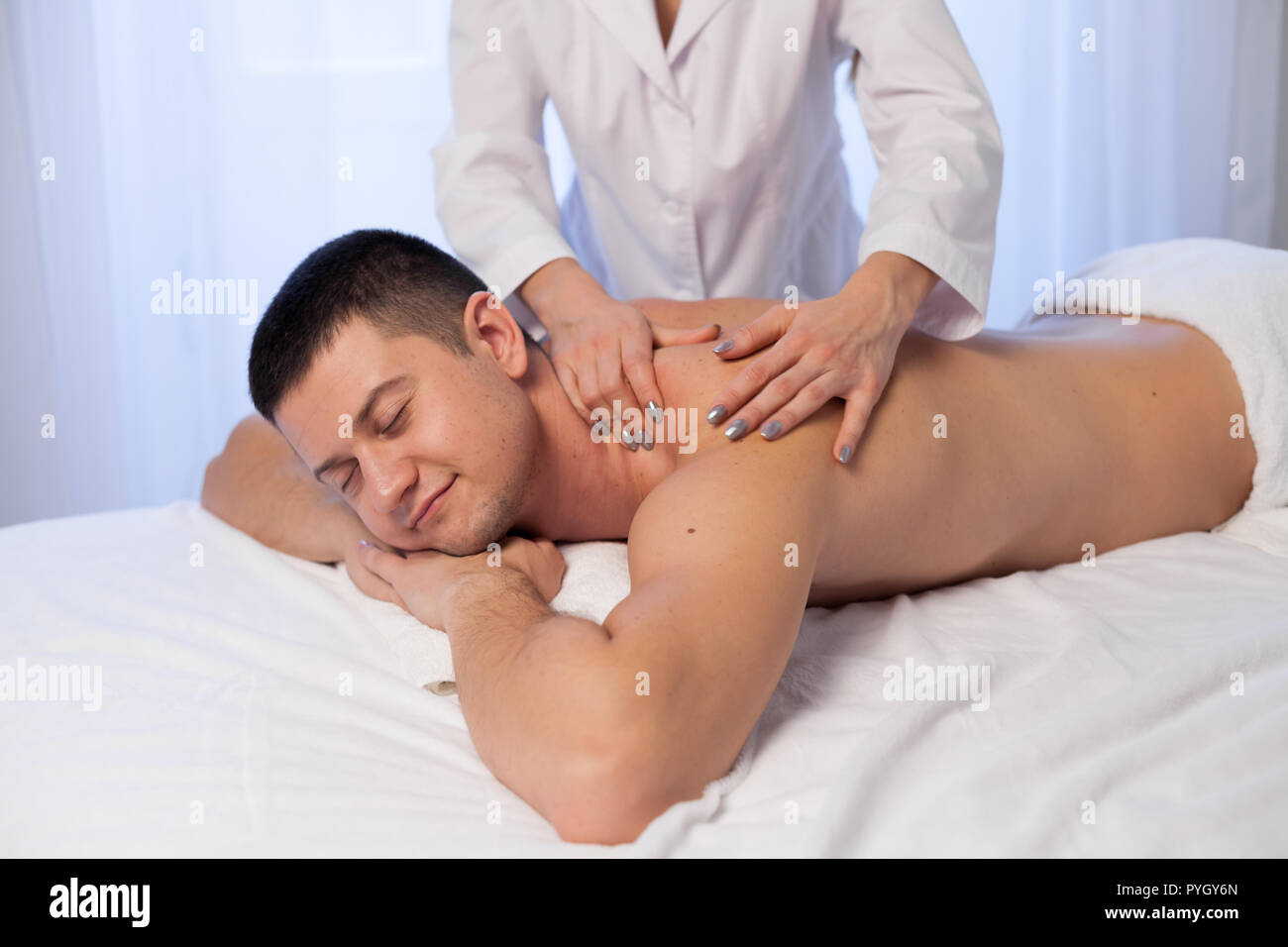 man doing medical massage hands person in Spa - Stock Image