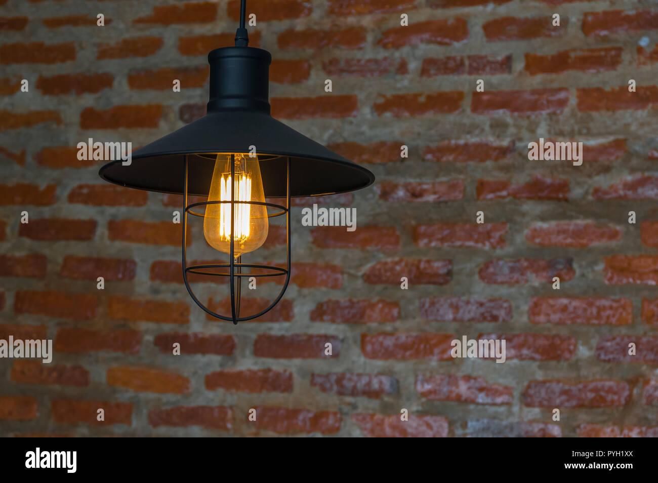 Luxury lighting decoration over the brick wall background Stock Photo