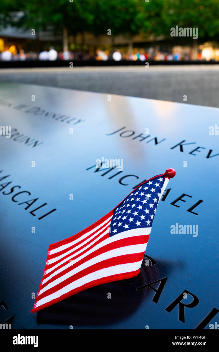 The names of some of the victims marked by the American flag on the 9/11 World Trade Centre Memorial fountains in Lower Manhattan, New York City Stock Photo