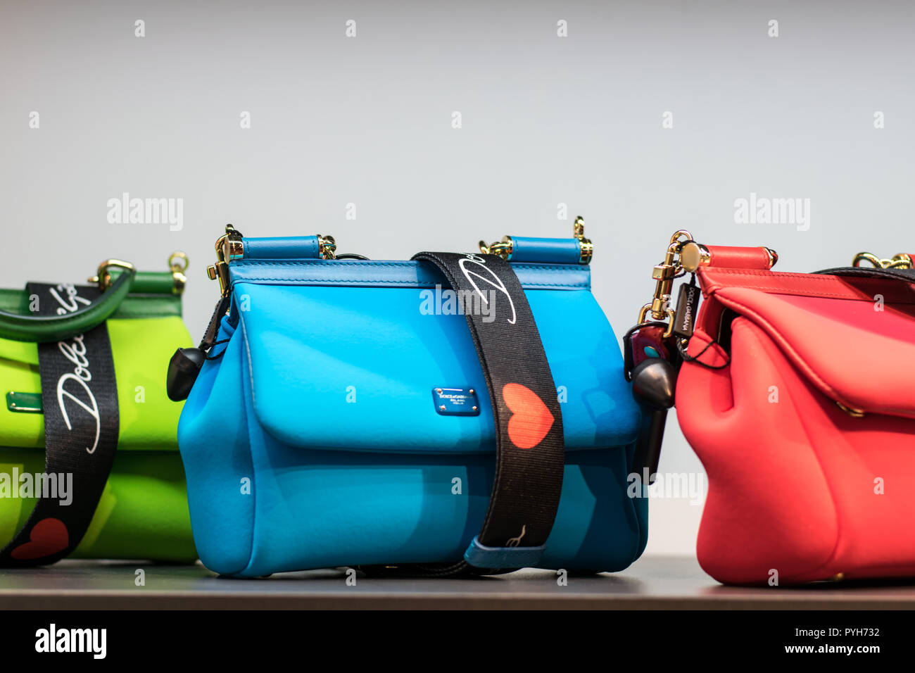 Colorful handbags from Dolce and Gabbana in German boutique - Stock Image