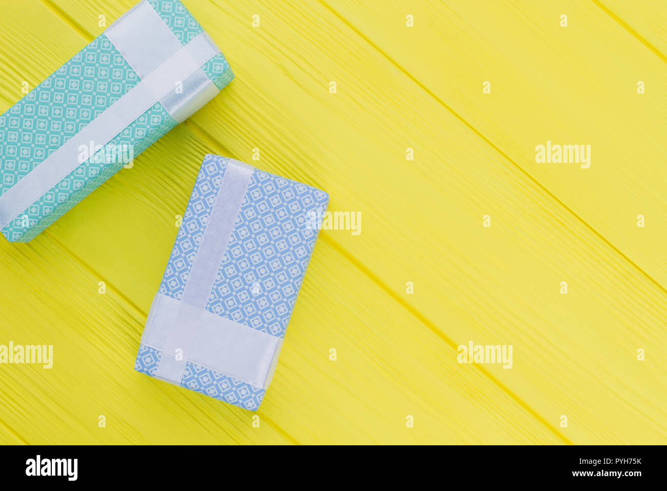 Gift Boxes With Beautiful Design On Yellow Background Gift Boxes