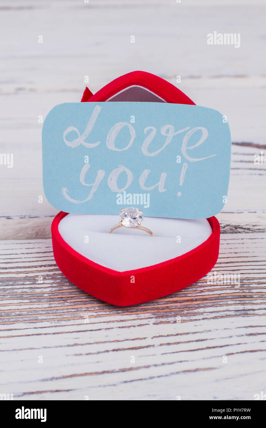 Engagement Ring In Box And Love Message Golden Ring In Red Velvet Box And Card With Inscription Love You Valentines Day Background Stock Photo Alamy