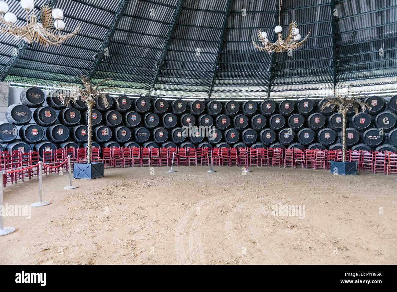Rows of sherry barrels at the Gonzalez Byass winery Jerez, each one has a flag representing every coutry the sherry is exported to. - Stock Image
