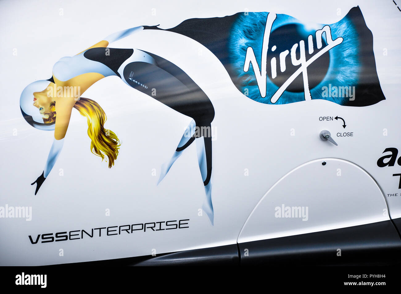 VSS Enterprise was the first SpaceShipTwo (SS2) spaceplane, built by Scaled Composites for Virgin Galactic. Nose art with female figure in space - Stock Image