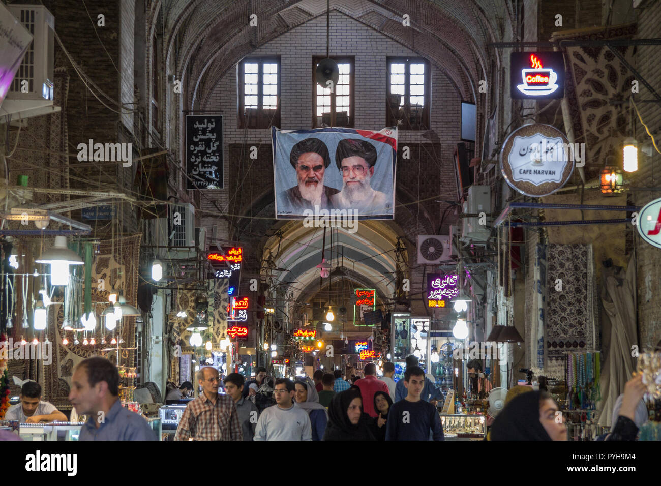 ISFAHAN, IRAN - AUGUST 8, 2018: Street of the Isfahan bazarw ith the portraits of the 2 Supreme leaders of the Islamic Republic of Iran, Ali Khamenei  Stock Photo