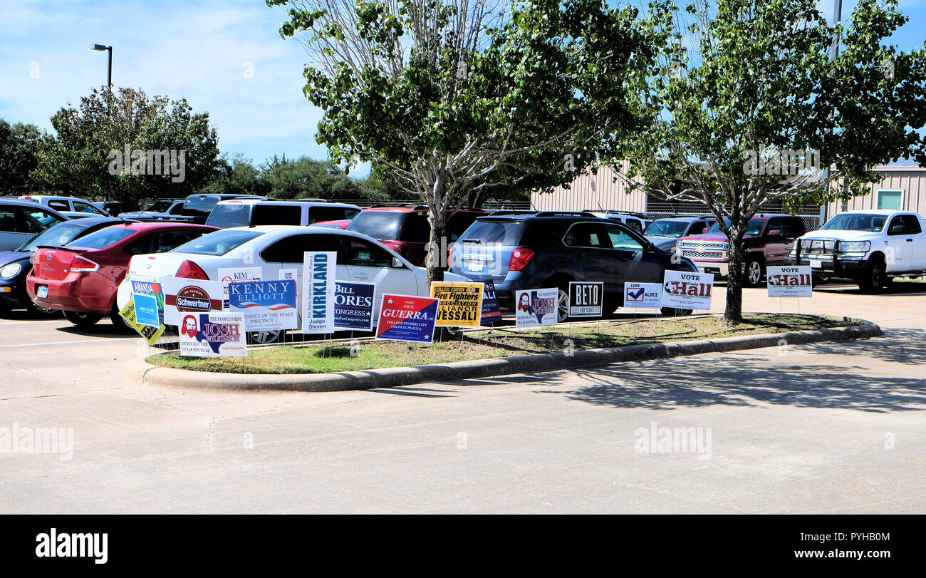 Campaign signs outside an early polling venue during the 2018 midterm elections in College Station, Texas, USA. - Stock Image