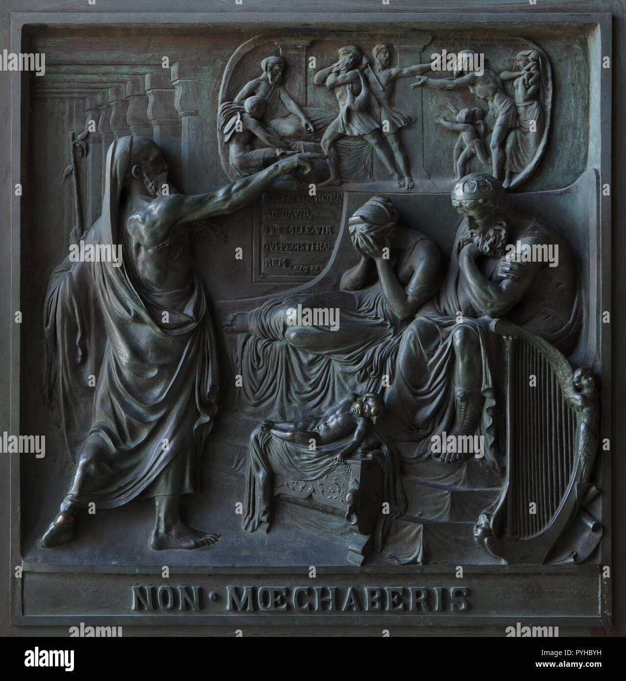 Thou shalt not commit adultery. Bronze bas relief by French sculptor Henri de Triqueti with assistance from Etienne Hippolyte Maindron (1834-1841) on the main doors of the Madeleine Church (Église de la Madeleine) in Paris, France. The Old Testament story of King David, seated beside Bathsheba, overcomed with remorse as the stern prophet Nathan confronts him are depicted to illustrate one of the Ten Commandments. - Stock Image