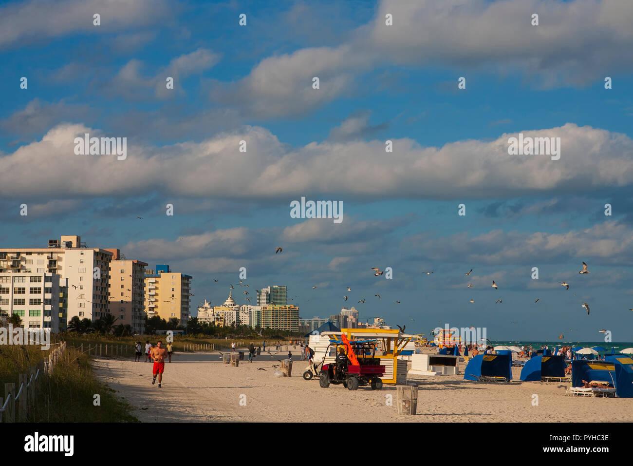 Man jogging on the beach, Miami Beach, Florida. - Stock Image