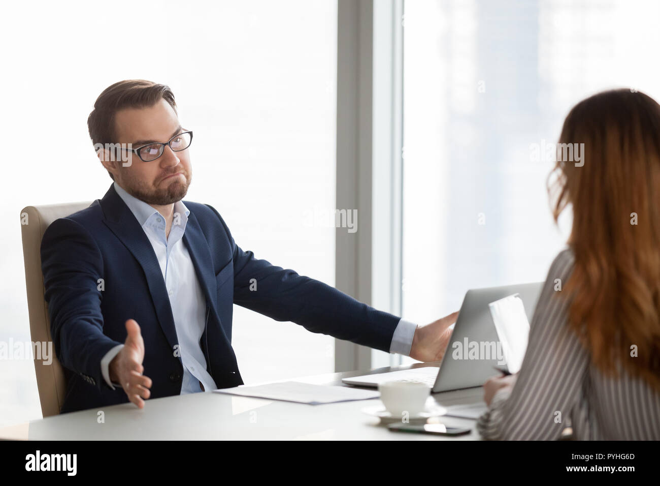 Not sure doubtful businessman at meeting with partners - Stock Image