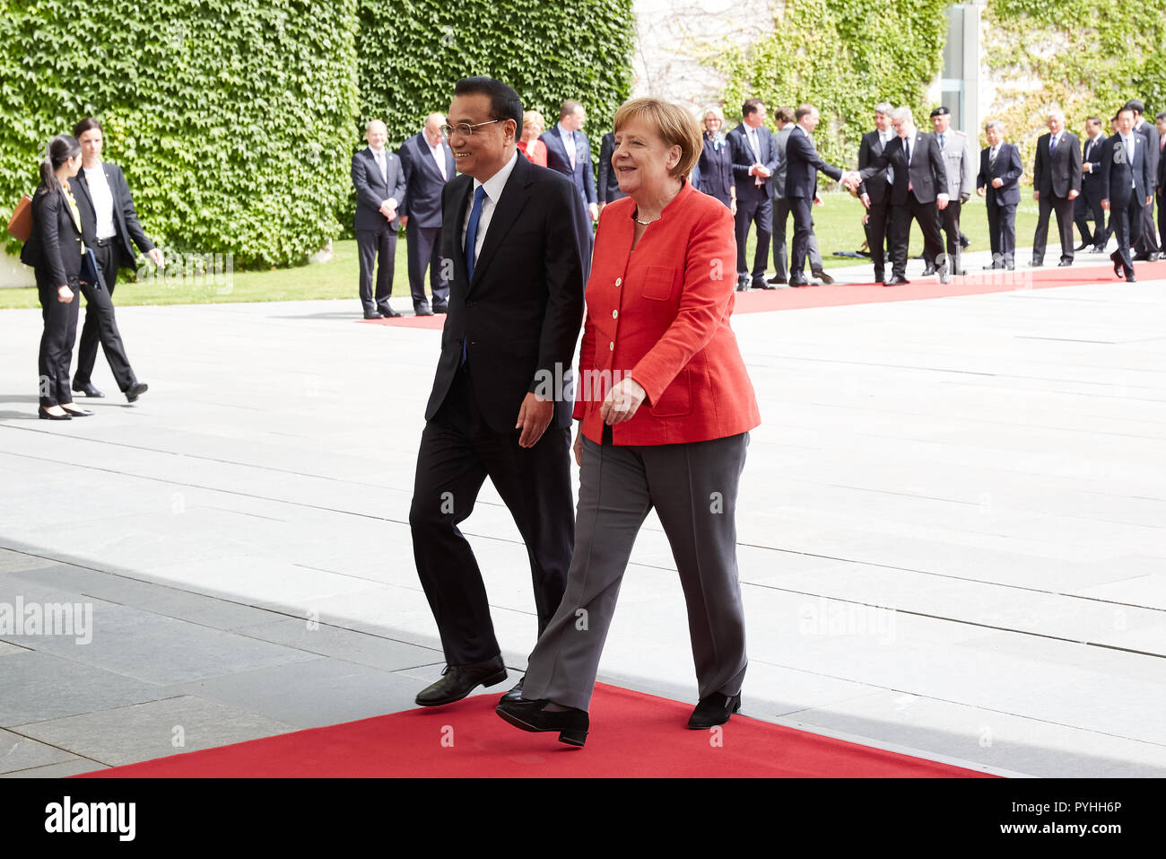 Berlin, Germany - Chancellor Angela Merkel and Chinese Prime Minister Li Keqiang leave the Chancellor's Court of Honour after receiving military honours. - Stock Image