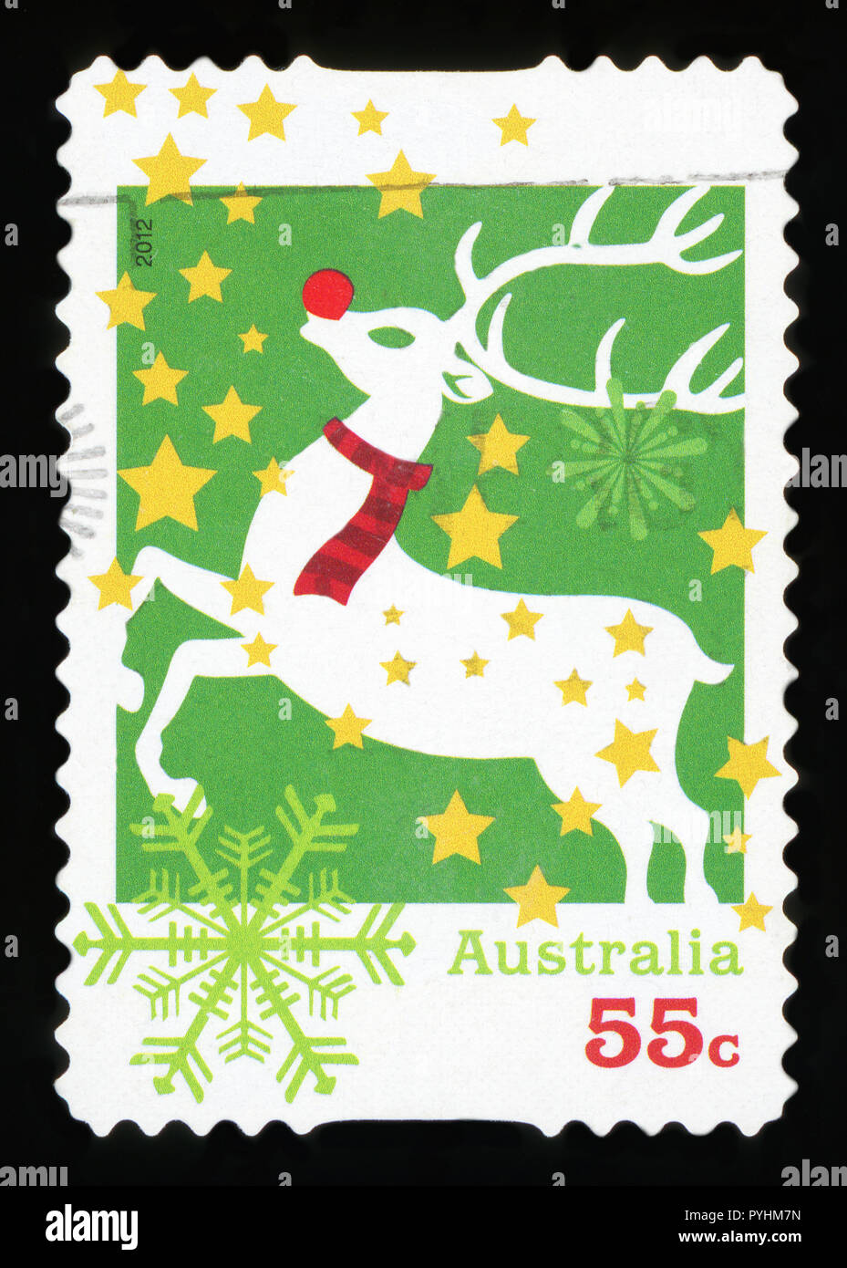 AUSTRALIA - CIRCA 2012: A used postage stamp from Australia, depicting an illustration of Rudolph the red-nosed Reindeer, celebrating Christmas, circa - Stock Image