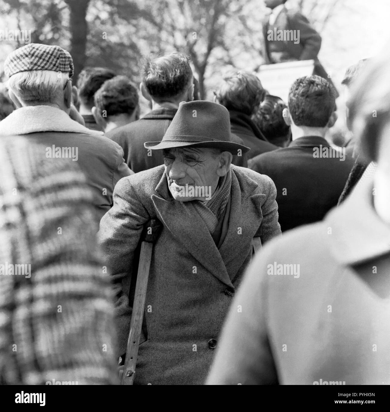 An elderly male invalid attending a political rally at Hyde Park London in the 1960s.. Stock Photo