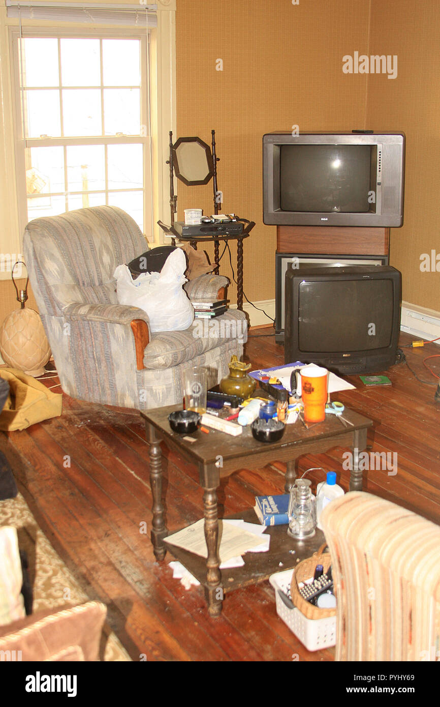Untidy, messy living room in U.S.A. - Stock Image